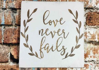 Small Sign- Love never fails