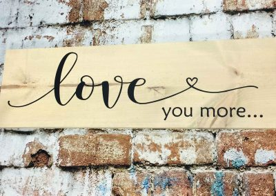 Love you more is not a canvas sip and paint class, this wine and paint workshop is DIY wood sign