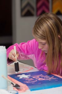 Board and brush. Kids parties at the trendy party venue in Traverse City. Painting classes, art classes, crafts and fun.