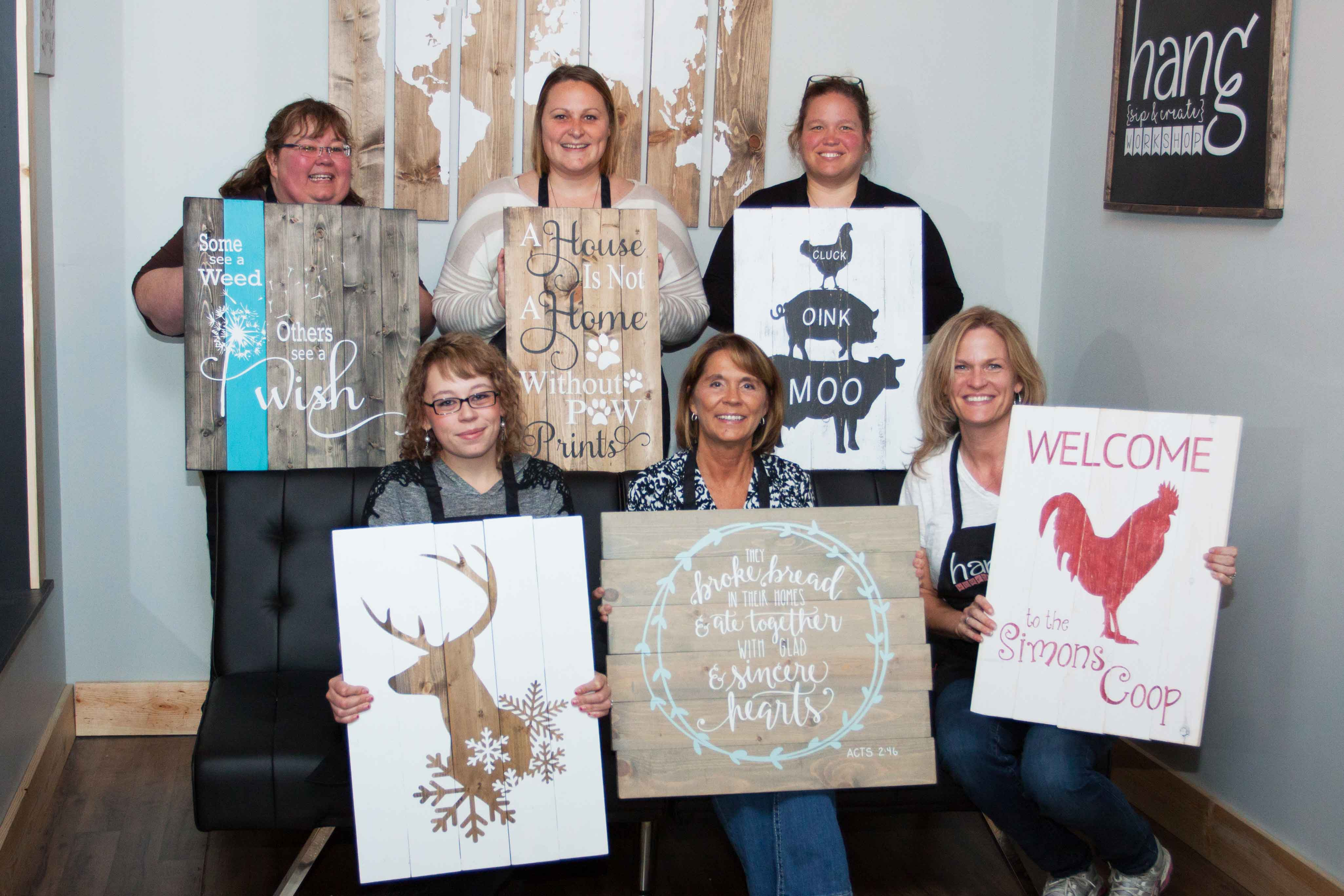 Paint and sip Private party in Traverse City Michigan. Painting class attendees each choose their own design and paint and sip and dab to create wood sign art.