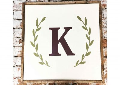 Single letter monogram with laurel swag