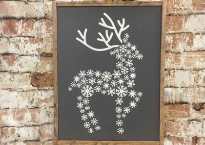 deer patterned from snowflakes is not a canvas sip and paint class, this wine and paint workshop is DIY wood sign
