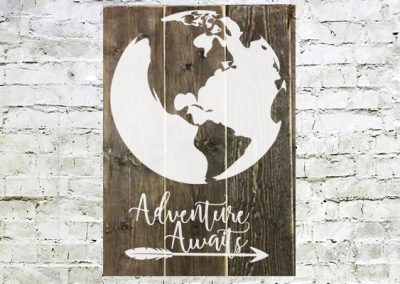 Adventure awaits large sign