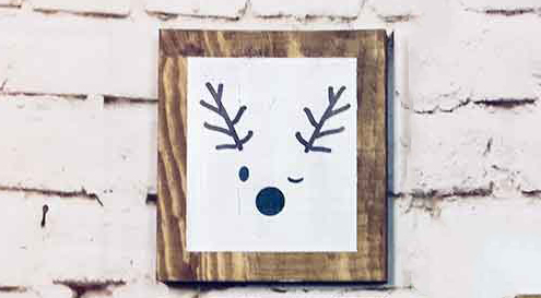 Small sign reindeer winking